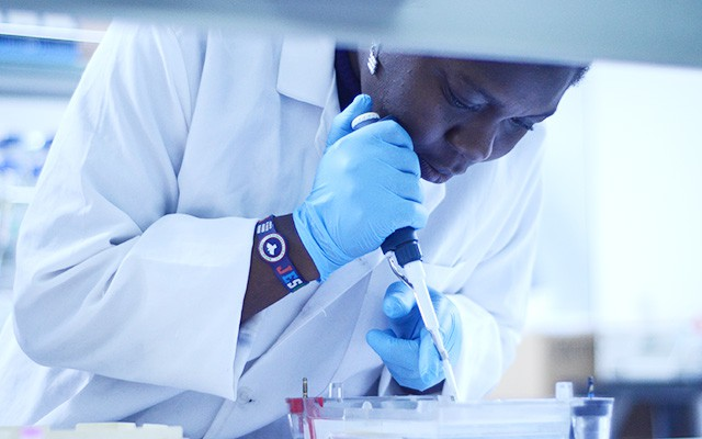 Oriola Olasunkanmi Bukoa of Nigeria working in a lab at the Centre of Excellence for Biotechnology