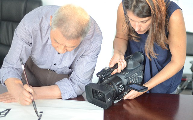 Nicole Leghissa films Zeng Qing-cun, a TWAS Fellow and the founder of Centre of Excellence for Climate and Environment Sciences, as he practices calligraphy.