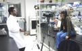 Qari Muhammad Kaleem of Pakistan is interviewed by filmmaker Nicole Leghissa in a lab at the Centre of Excellence for Biotechnology.